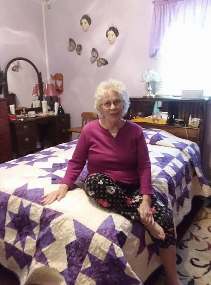 "Alice B. with her ""Festive Stars"" quilt"