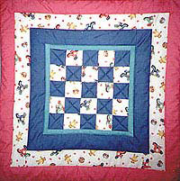 """Easy Preemie Quilt"" Free Charity Quilt Pattern designed by the Fraser Valley Quilters Guild, Surrey, British Columbia from Project Linus brought to you by BOMquilts.com"