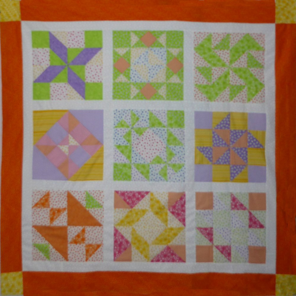 """Harry Loves Alice"" 2019 Free Block of the Month Quilt from BOMquilts.com designed by TK Harrison. Finished Quilt Top. Made by Meloney F."