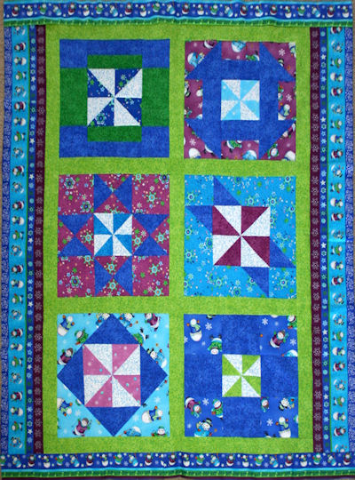 Pinwheel Snowflakes for Winter Joy Originally Designed by BOMquilts.com