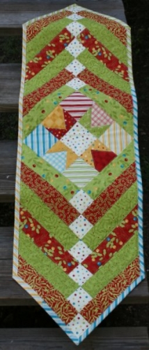 Holly Jolly Funtabulous Star Quick Table Runner from BOMquilts.com