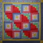 Log Cabin Off Kilter Lap Quilt designed by TK Harrison for BOMquilts.com