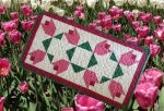 Ode to Tulip Time an Original Design and Free Quilted Table Topper Pattern by TK Harrison, Owner of BOMquilts.com